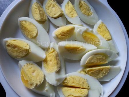 Boil and quarter eggs for Honey Fried Eggs Recipe