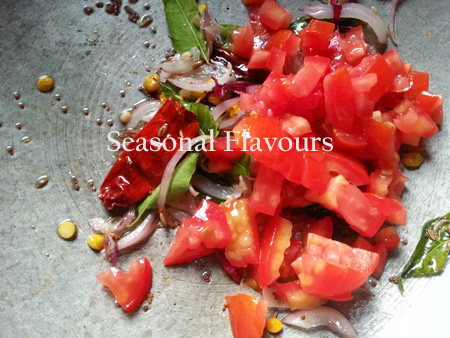 Chopped tomatoes and hing for spiced tomato rice Andhra style recipe