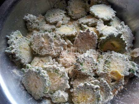 Mix together the dry ingredients for crispy karela chips recipe