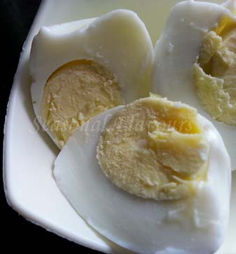 Halve boiled eggs for egg mayo salad recipe