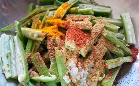 add spices to okra for Indian bhindi recipe