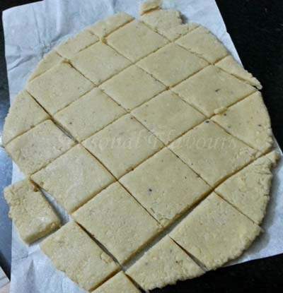 cut the rolled out cashewnut dough into barfi pieces for fudge recipe