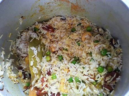 Add soaked rice for yellow pulao recipe