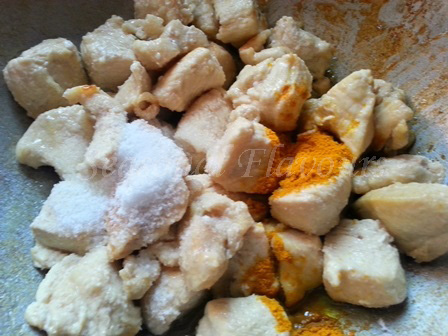 Add salt and haldi for Andhra chicken curry recipe