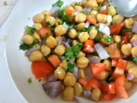 Add chickpea dressing to salad ingredients