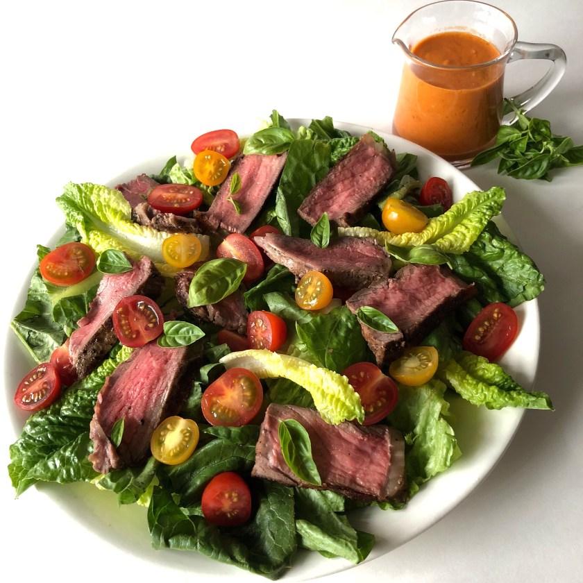 steak salad with roasted cherry tomato vinaigrette