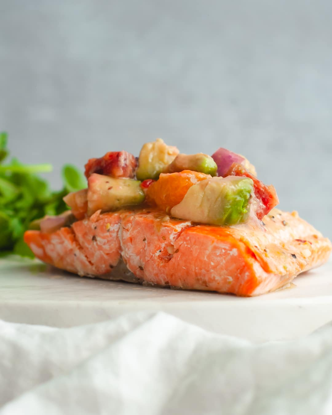 easy seared salmon topped with citrus avocado salad