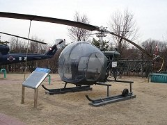 OH 13E helicopter