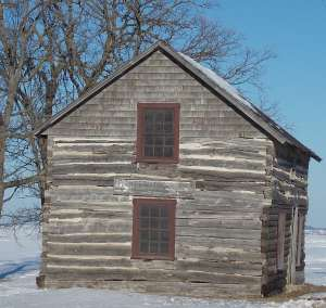 Thought you might enjoy this old log cabin picture. Imagine raising a family in that!