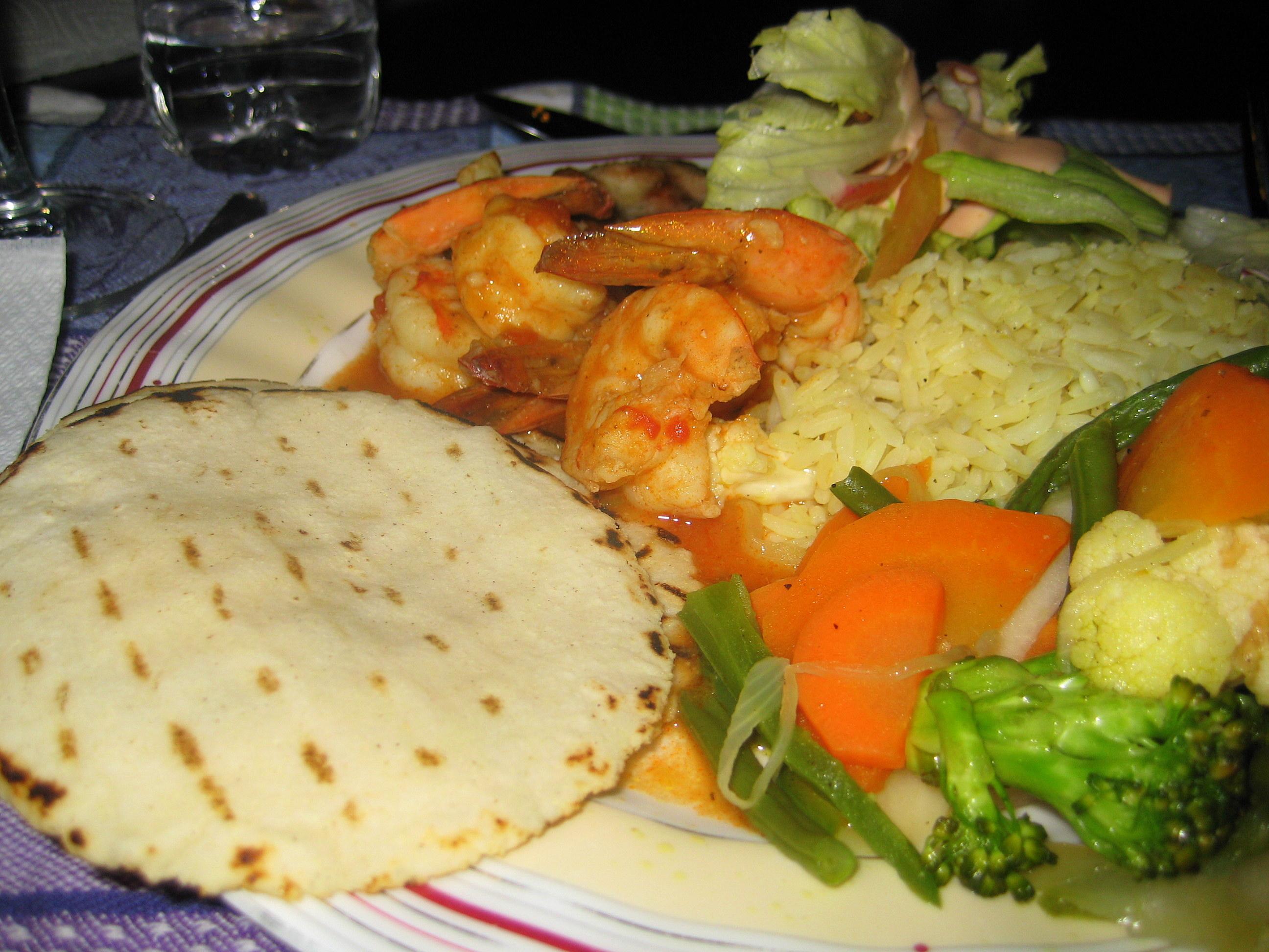 Shrimp with rice, veggies and tortillas