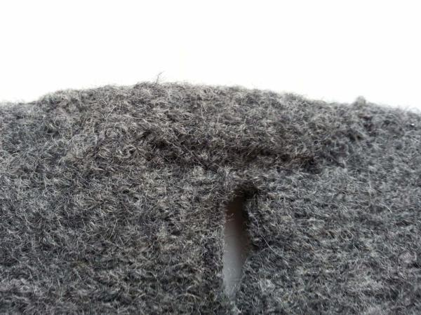 close up photo of mended wool sweater