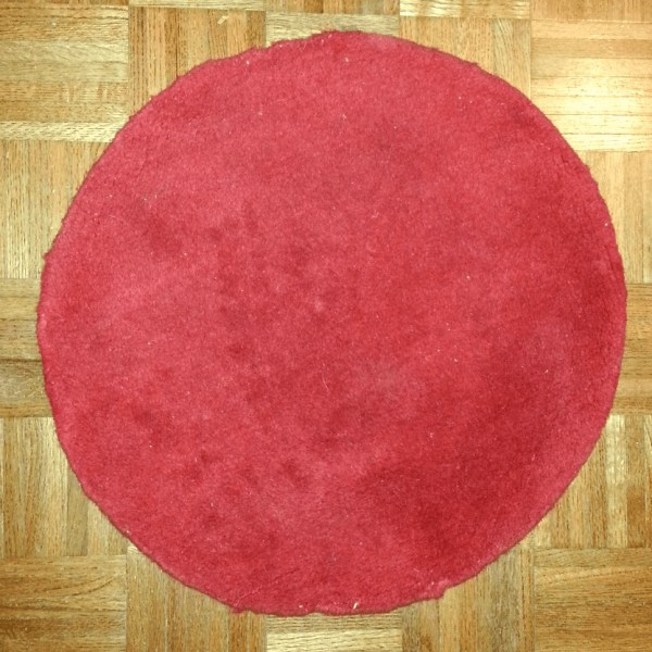 red circular rug
