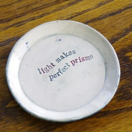 Small poetry plate (light makes prisms)