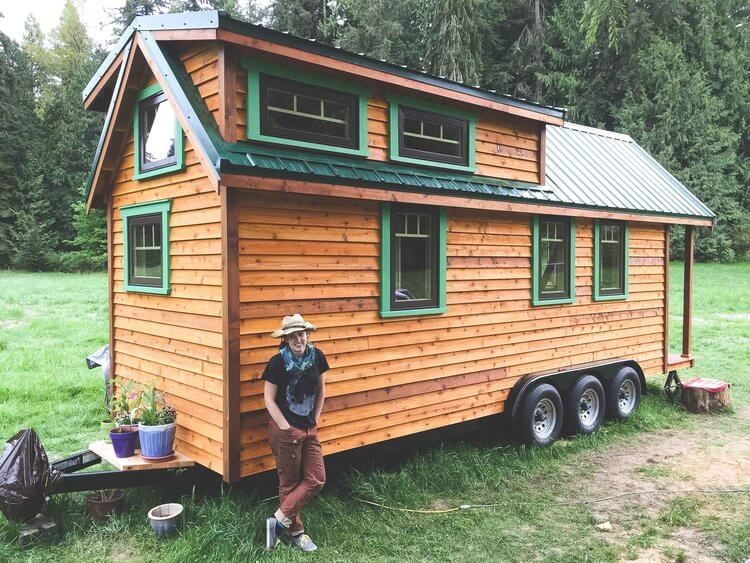 Artist Laurel Mundy by her tiny home