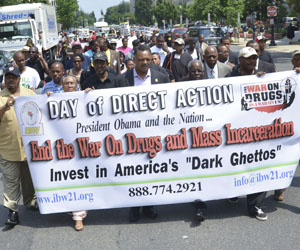 Ron Daniels (black cap, black shirt) president of the Institute of the Black World 21st Century and Rev. Jesse Jackson, Jr. (center) lead a march protesting the War on Drugs in Washington, D.C. (Freddie Allen/NNPA).