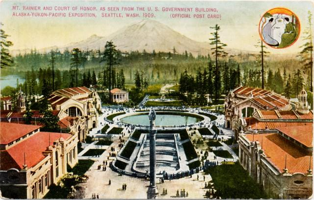 """colorized photo from old postcard showing aerial view of central plaza, bordered by red-roofed buildings, with cascading pools to large round pool, all centered on-axis with a distant view to Mt. Rainier. Text on postcard reads, """"Mt. Rainier and Court of Honor, as seen from the US Government Building, Alaska-Yukon-Pacific Exposition, Seattle, Wash., 1909. (Official Post Card)"""""""