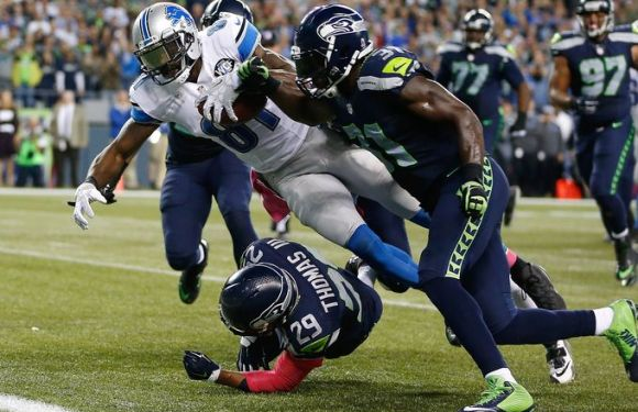 Seahawks punch their way to 2-2, beat game Lions 13-10