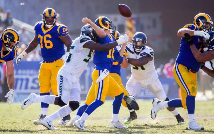 Seattle Seahawks defensive end Frank Clark sacks LA Rams QB Jered Goff. (Mike Siegel / The Seattle Times)