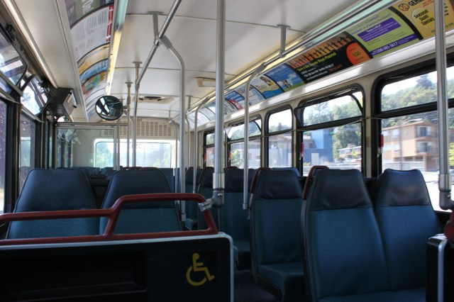 Photo of Route 42 bus interior, completely empty.