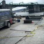 Metal Fabrication on wharf near bridge