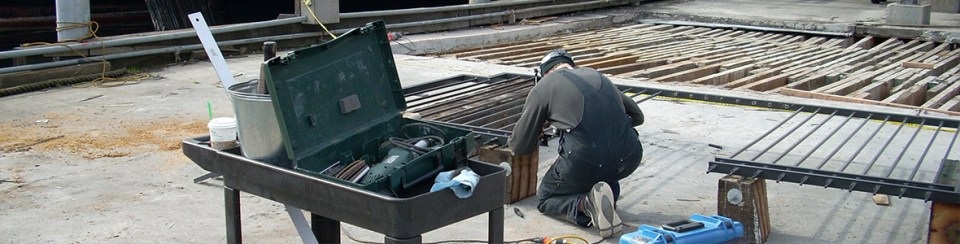 Construction site with Welder working
