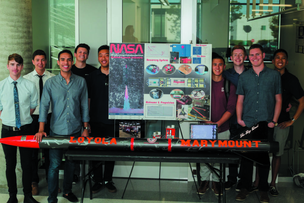 Seaver students, their research poster, and demonstration table