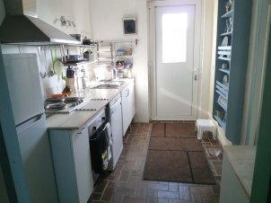 8) Kitchen. View towards the front door. Fridge/freezer, Dishwasher