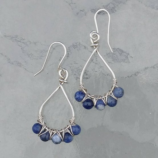 Sodalite beads woven on silver teardrop earrings