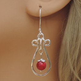 Ruby and Silver Earrings on mannequin