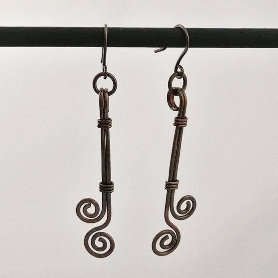 image of long copper earrings with spirals