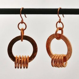 image of textured copper washer and coil earrings