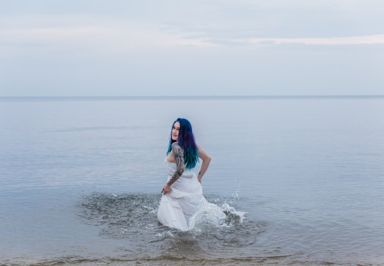 woman in white , with blue hair water fine art portrait ,sexy long island