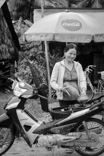 Filling up motor bike around Kep