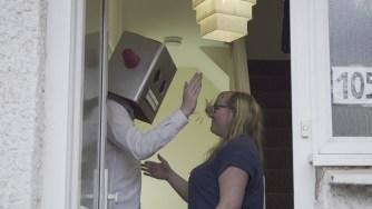 Robot masks don't make high fives easy...