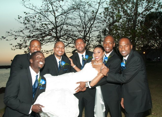 bride held by groomsmen