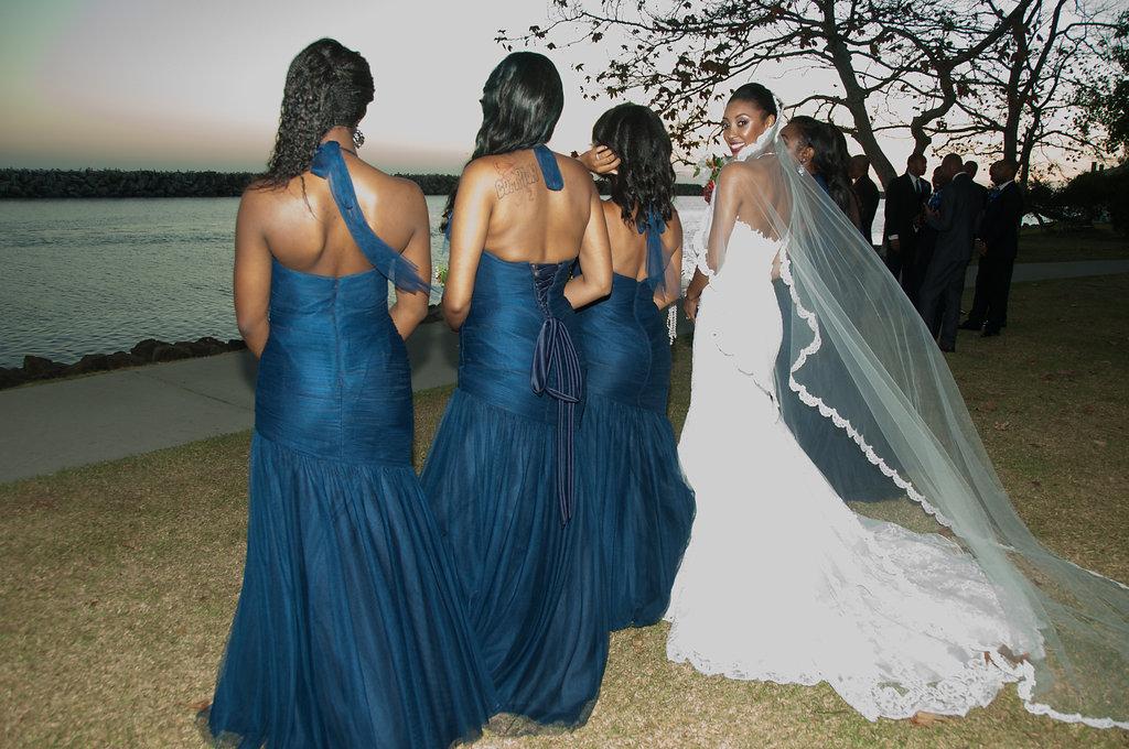 bride in row looking at camera