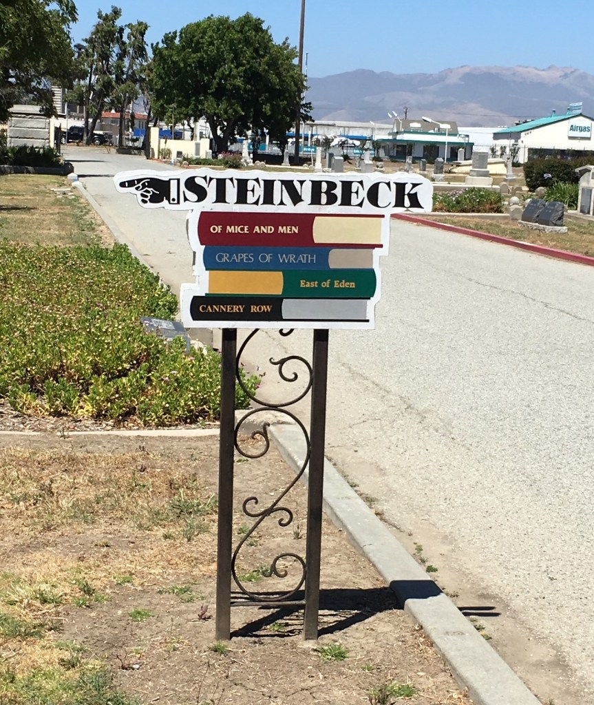 Steinbeck sign finger pointing to Steinbeck's grave