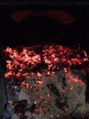 coals and flames in the woodstove