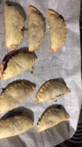 half-circle hand pies cooling on the pan
