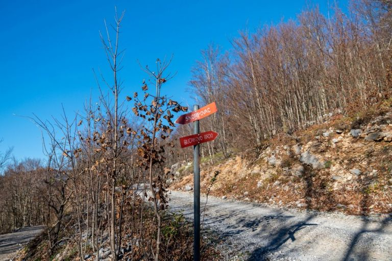 Signs for hikers to villages on Velebit