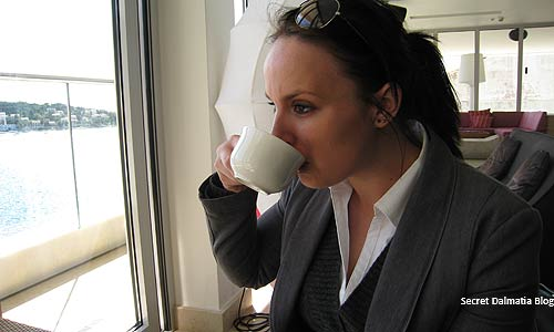 Marija sipping coffee in Adriana's roof top cafe