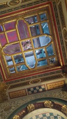 Mirror selfies in the ceiling.