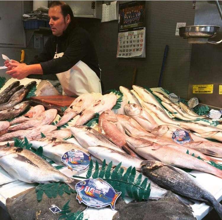 Fishmonger at Mercado Central Atarazanas