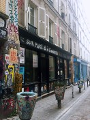 Graffiti everywhere on Rue Denoyez - self-guided tour of Belleville and Ménilmontant