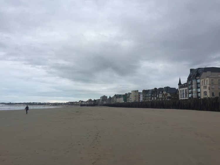 A lone man on the beach - Guide to the best tourist attractions, places in Brittany