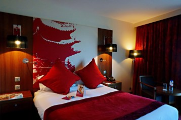 Bedroom at Crowne Plaza Corum - Things to do in Montpellier