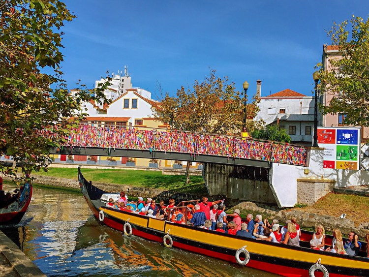 People enjoying a boat ride on a molineiro - Things to do in Aveiro