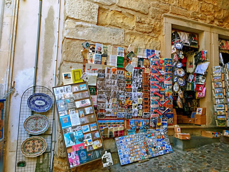 Front of a souvenir shop with lots of postcards - One day in Coimbra