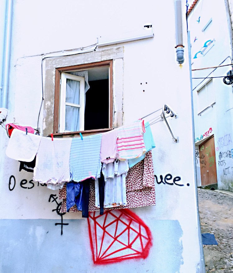 Clothes hanging outside a window - One day in Coimbra