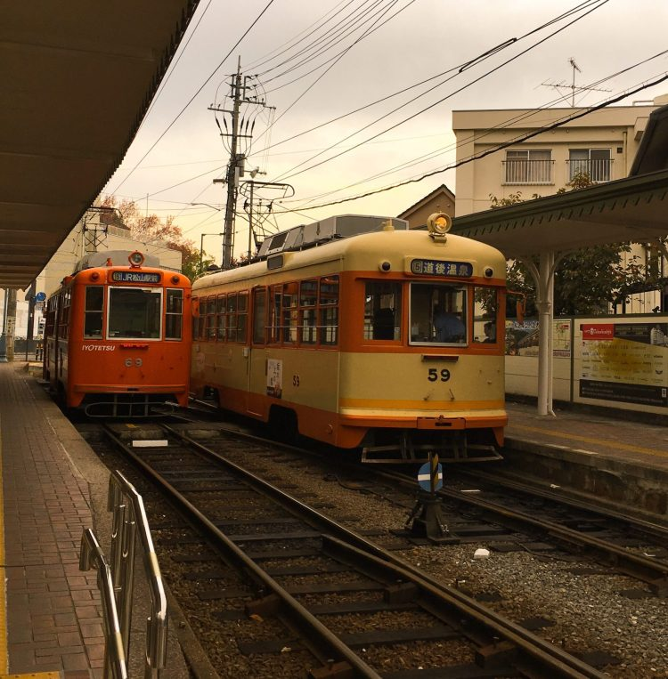 Orange and yellow trains at stations